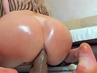 Riding A Big Dildo In Ass And Pussy